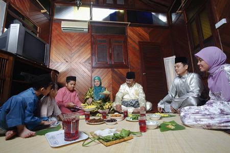 senior eating: Family eating together