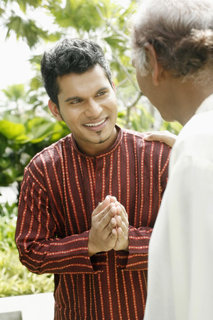 only two people: Man greeting his father