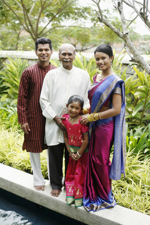 kurta: Family portrait by the pond side LANG_EVOIMAGES