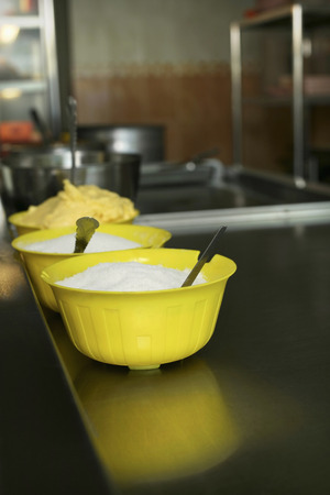 medium group of objects: Bowl of sugar, margarine and other ingredients for making roti canai