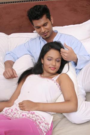 kurta: Woman sleeping, man playing with her hair