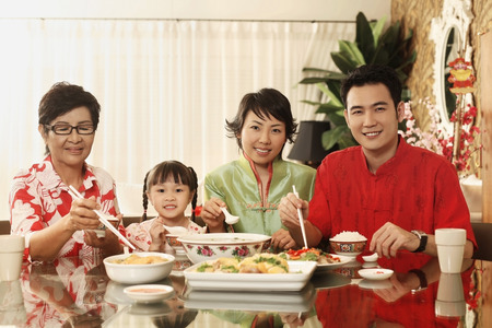 having lunch: Couple and girl having lunch together with senior woman