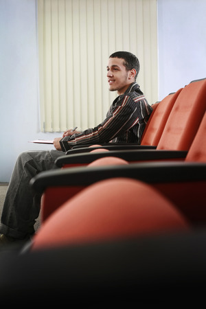 Man sitting in lecture hall