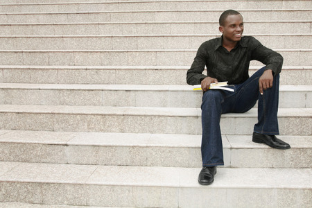 college life: Man sitting at the staircase