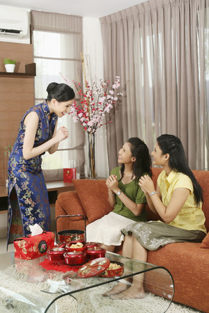 her: Woman greeting her friends during Chinese New Year