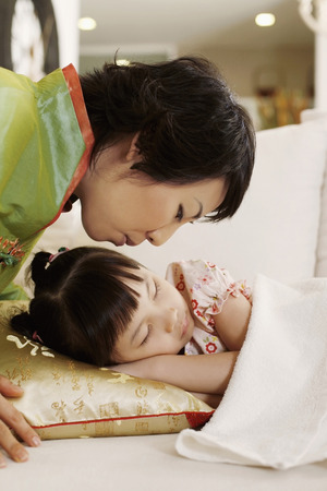 about age: Woman about to kiss a sleeping girl LANG_EVOIMAGES