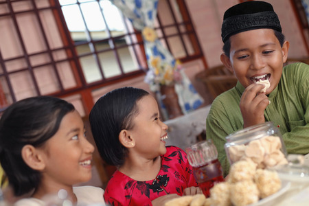 Children enjoying traditional cookies LANG_EVOIMAGES