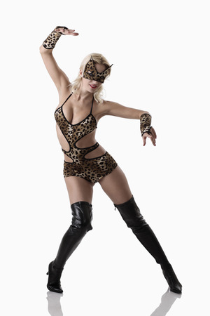 erotic fantasy: Woman in leopard costume posing for the camera
