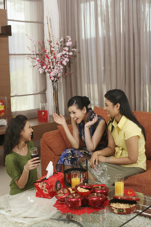 Women talking during Chinese New Year gathering 免版税图像