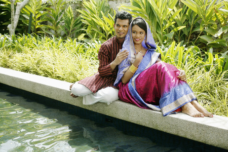 bindi: Man and woman relaxing by the pond side