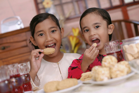 biscuits: Girl enjoying traditional cookies LANG_EVOIMAGES