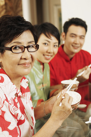 having lunch: Senior woman having lunch together with man and woman