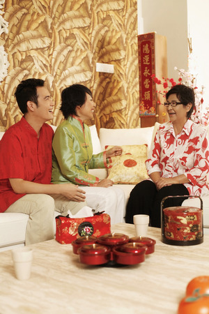 three people only: Man and woman having a good time talking to senior woman