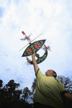 preadolescent: Boy flying moon-kite