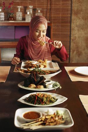 Woman enjoying a variation of food