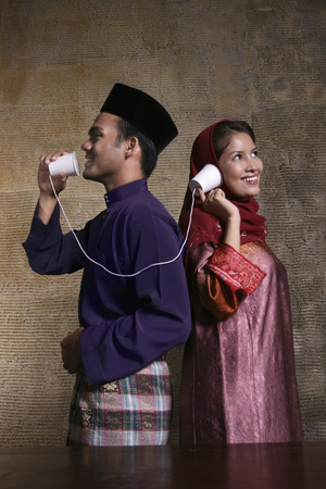 tin can telephone: Man and woman communicating through tin can telephone