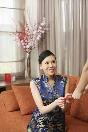 red packet: Woman in cheongsam receiving red packet