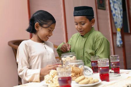 Boy and girl enjoying traditional cookies