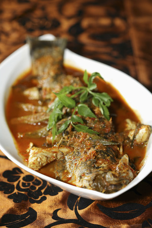tangy: Sea bass simmered in a tangy chilli and tamarind gravy with okra and aubergine