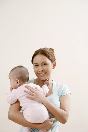 carrying: Woman carrying baby