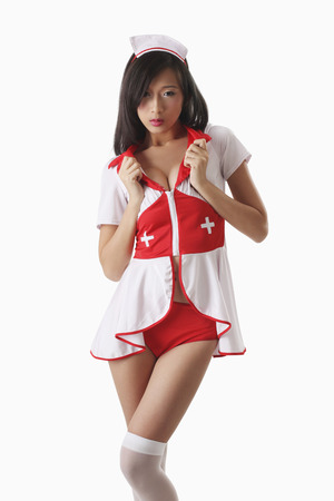Woman in nurse outfit 스톡 콘텐츠