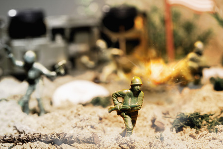 Toy soldiers fighting on battlefield