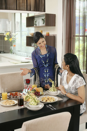 inviting: Woman inviting her friend to eat