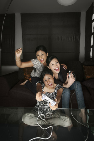 console: Women playing video game console