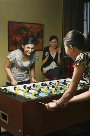 foosball: Women playing foosball