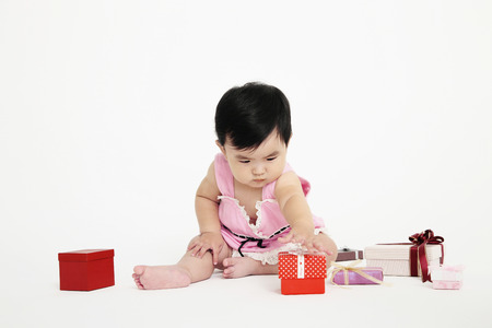 reaching out: Baby girl reaching out to take gift box