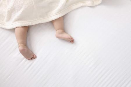 babys: Babys barefeet under blanket