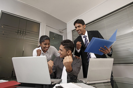 jubilating: Business people celebrating their success