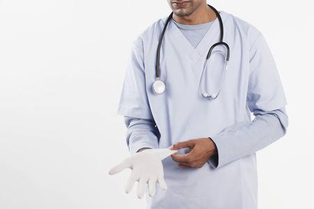 surgical glove: Doctor putting on surgical glove