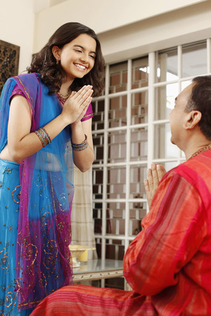 kurta: Teenage girl and man greeting each other LANG_EVOIMAGES