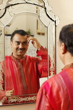 kurta: Man checking his hair in the mirror