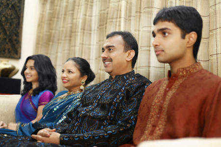 kurta: Family sitting in a row
