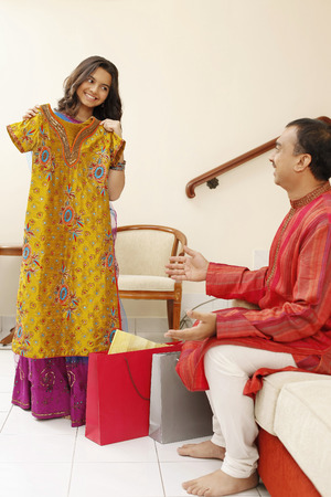 salwar: Teenage girl showing man her new clothes