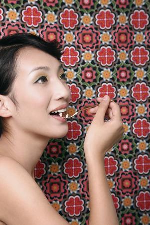 woman eating cake: Woman eating cake LANG_EVOIMAGES