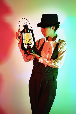 vintage: Woman with hat holding antique lantern LANG_EVOIMAGES