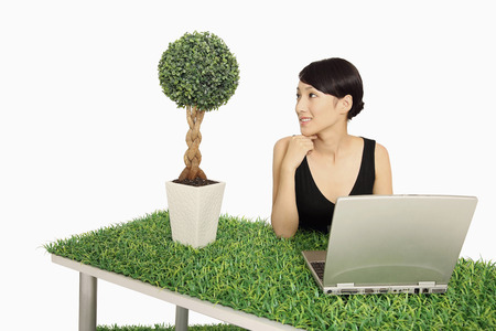 potted plant: Woman looking at potted plant