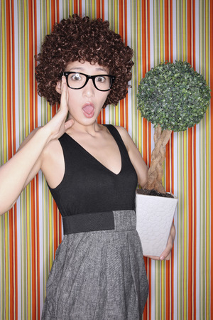 potted plant: Woman carrying potted plant looking shocked