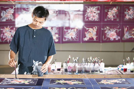 man painting: Man painting batik fabric LANG_EVOIMAGES