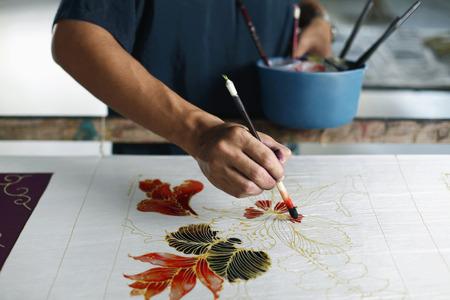 Man painting batik fabric Archivio Fotografico