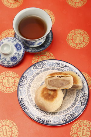 medium group of objects: Mooncakes and cup of tea LANG_EVOIMAGES