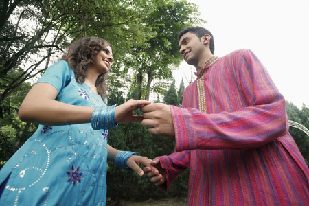 salwar: Man and woman holding hands and looking at each other LANG_EVOIMAGES
