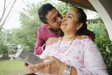 salwar: Man giving senior woman a peck on the cheek