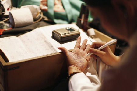 one mature woman only: Opera performer writing script on her palm