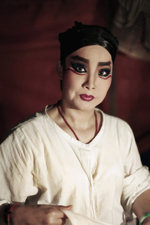 one mature woman only: Opera performer with thick make-up