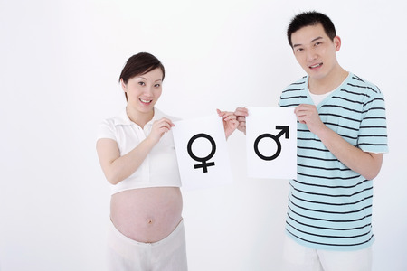 two people fertility: Man holding boy symbol, pregnant woman holding girl symbol LANG_EVOIMAGES