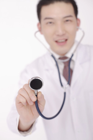 sensory perception: Doctor holding stethoscope